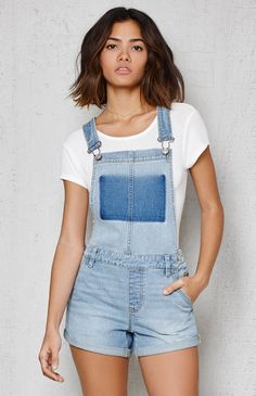 Fashionable and functional, the Ghost Blue Denim Shortalls have a retro-inspired feel. Adjustable shoulder straps lend a customized fit, while a contrast wash at the bib mimics a pocket. These shortalls are finished with a mid-blue wash for an easy go-to. Denim Fashion, Fashion Outfits, Overalls Outfit, Dungarees, Festival Shorts, Lifestyle Clothing, Summer Outfits Women, Pacsun, Blue Denim