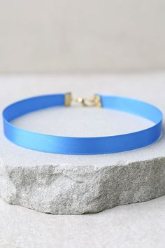 """To throw the best parties, you need the best accessories, that's why we love the Gracious Hostess Teal Blue Choker Necklace! A 0.25"""" wide shiny satin ribbon forms this chic choker necklace. Necklace measures 11.75"""" long with a 2"""" extender chain."""