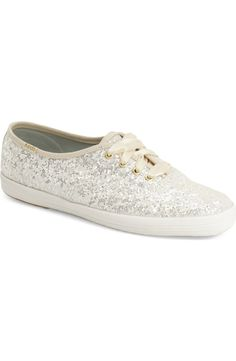 Adding some sparkle to the look with these ultra cute sneakers in white glitter by Keds and Kate Spade.