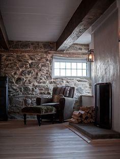 Vintage barn frame addition to Dutch stone house