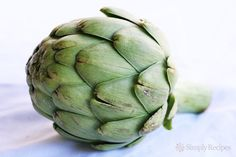 How to cook and eat an artichoke, with step-by-step instructions and photos.
