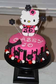 Hello Kitty- Hot Pink and Black decorations. Vanilla cake with Vanilla buttercream filling!