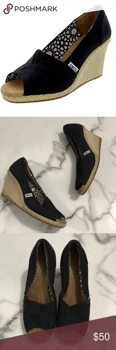 Toms black wedges Size 9 black peep toe Tom wedges. Overall condition is great some darker blemishes on the bottom edge of the espadrilles Toms Shoes Wedges