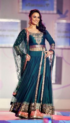 teal and pink Manish Malhotra's outfit
