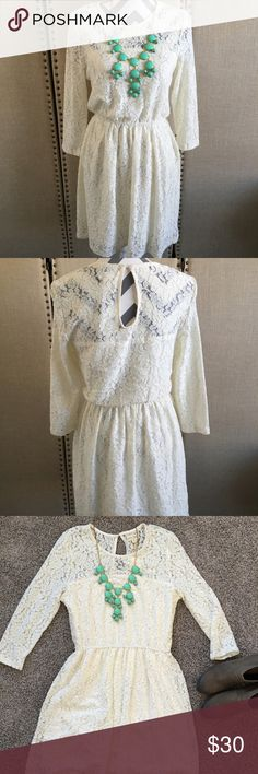 NWT long sleeve lace dress NWT lace dress with long sleeves shell made of 49% cotton 44% nylon 5% rayon 2% spandex lining made of 100% polyester. Measurement shoulder to hem 33 1/2 inches. Has a good amount of stretch. Dresses