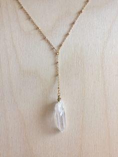 A personal favorite from my Etsy shop https://www.etsy.com/listing/519482027/angel-aura-quartz-lariat