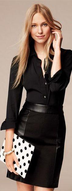 Shop this look on Lookastic:  https://lookastic.com/women/looks/black-dress-shirt-black-pencil-skirt-white-and-black-clutch-white-bracelet/11530  — Black Dress Shirt  — Black Leather Pencil Skirt  — White Bracelet  — White and Black Polka Dot Clutch