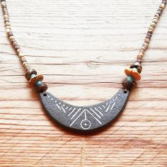 classic Adamaia pendant Necklace in earth colors with joyful turquoise beads, coconut beads and wooden beads A simple and charming necklace that would fit to daily life The pendant is handcrafted out of clay, burned to a high temperature in a special kiln, so its very solid, gives the