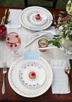 LOVE THE GOLDWARE AND THE LINEN MENU! and the gold ring at the top of the glass. Southern Weddings Magazine