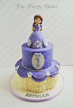I made this Princess Sophia the First cake for a sweet little girl turning one year old.  The cakes are 6 and 9 inches decorated with buttercream, buttercream ruffles and fondant swags and flowers.  Princess Sophias skirt is also cake made from the mini Wilton Wonder Mold and decorated with fondant.  The figure is made from fondant.   TFL!