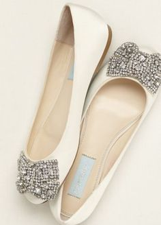 Ultra-feminine and comfortable encrusted bow flat!  Blue by Betsey Johnson satin flat features crystal embellished bow detail.  Fully lined. Imported.