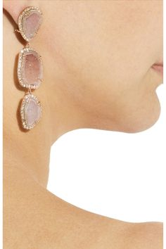 @Urban Decay KIMBERLY MCDONALD 18-karat rose gold, geode and diamond drop earrings Using reclaimed and raw materials, these 18-karat rose gold earrings sparkle with an organic beauty. Let the pink agate geode and 1.91-carat diamonds shine with barely-there makeup and loose, natural locks. For pierced ears. 15,295 USD