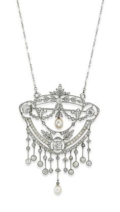 AN EARLY 20TH CENTURY PEARL AND DIAMOND BROOCH / PENDANT NECKLACE -  The broad shield shaped openwork panel, with central pearl drop to a millegrain-set old and rose-cut diamond-set laurel leaf, scroll and swag surround, suspending a further pearl drop and old-cut diamond knife bar fringe, circa 1905.