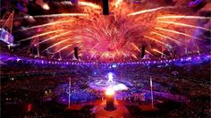 Fiery sky lights Stadium below    The Paralympic Cauldron burns in the foreground, with a large-scale version of the celebrated Alison Lapper Pregnant sculpture located behind, and dramatic fireworks overhead.