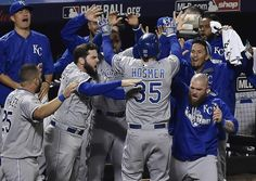 Kansas City Royals first baseman Eric Hosmer is swarmed by teammates after he scored the tying run in the ninth inning during game five of the World Series on Sunday, November 1, 2015 at Citi Field in New York.