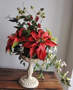 Beautiful arrangement for christmas with flowers made of cold porcelain