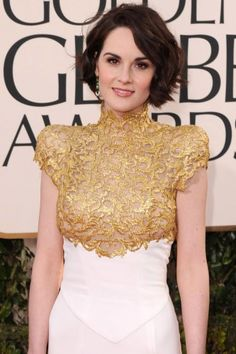 Michelle Dockery    We've never seen Michelle Dockery rock a red carpet like this. We love how she coupled her high-necked Alexandre Vauthier gown with a lovely wavy bob (hitting the '20s trend that will be huge this spring!) and sultry-yet-pretty makeup that highlights her gorgeous features.