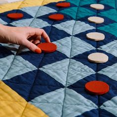 Roll out the quilted version of one of the oldest board games in existence. Novices and experts alike can play this classic, and then roll up the quilted board when the game is finished. Felt Games, Old Board Games, Sustainable Gifts, Living Room Flooring, Game Pieces, Machine Quilting, Baby Quilts, Hand Stitching, Old Things
