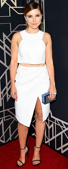 Sophia Bush is dressed in a Camilla and Marc top and skirt, Stuart Weitzman shoes, a clutch by Rauwolf and as29 jewelry at the Elle Women in Music event