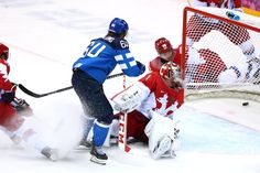 DAY Mikael Granlund of Finland and Semyon Varlamov of Russia compete during the Ice Hockey Men's Quarterfinals - Finland vs. Olympic Hockey, Ice Hockey, Winter Olympics 2014, Colorado Avalanche, Hockey Players, Finland, Nhl, Russia, Photo Galleries