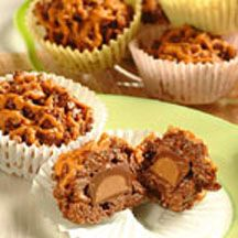 Peanut Butter Candy Cheaters - Toasted rice cereal combines with marshmallow crème and semi-sweet chocolate morsels to make great individual candy treat for snacks or bake sales. Don't forget the surprise in the centers! This 1st Place winning recipe was created in the kitchen of Rose Cordas of Mayfield Heights, OH.