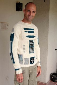 r2-d2-sweater I feel like even though this guy makes this sweater look kinda ugly...I would rock the shit outta it