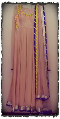 Indian culture in all it's glory, with this beautiful peach anarkali