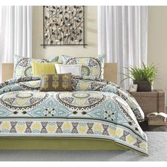The 200 thread count cotton sateen set features dusty shades of green, teal, brown and yellow and beautiful blue medallion motif that repeats across the comforter and is centered on each sham. A matching bedskirt and three pillows are also included.
