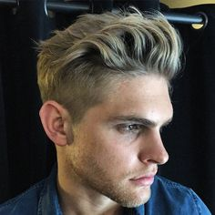 loose pompadour with clippers on sides and back