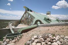 Check out this earthship's innovative way to collect rain water. A little more angle to that trough and you could have a great water slide.