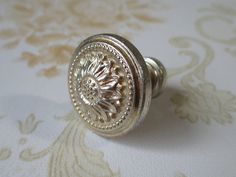 Antique Silver Sun Flower Dresser Drawer Knobs Pulls Handles / Shabby Chic Cabinet Handle Pull Knob / French Country Home Decor. $3.50, via Etsy.