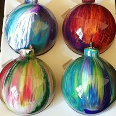 Painted Ornaments- Add a couple of drops of acrylic paint, one colour at a time into clear round christmas balls and swirl and tap. Gorgeous