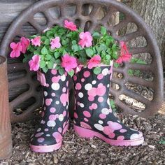 Antique tractor seat with new pretty boots and flowers