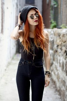 orange-red hair and black clothing!