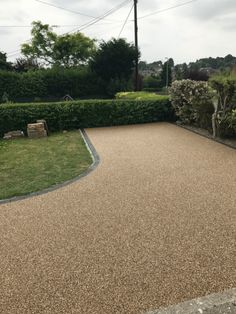 Resin Bound Driveways are mixed of natural aggregate, marble or recycled glass (stone) and clear resin. Book your free survey today or call 0800 1700 636 Resin Bound Driveways, Resin Driveway, Long Driveways, Clear Resin, Recycled Glass, Hampshire, Grass, Sidewalk, Country Roads