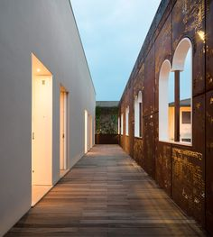 a 19th century venetian facade is recreated with a corten steel sculpture, reproducing the arched windows with a perforated metal screen.