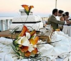 A Happy Couple And The Bridesmaids Enjoying Bermudas Beach