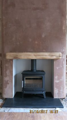 An ACR Rowandale multi fuel, cast iron stove Wood Burner Fireplace, Fireplace Ideas, Addison Road, Multi Fuel Stove, Cast Iron Stove, Log Burner, Fire Places, Moving House, Stoves