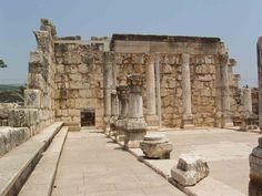 The white synagogue of Capernaum in Galilee, Israel, is located just inland from the shore with its facade facing Jerusalem. It stands on an elevated position, was richly decorated and was built of imported white limestone, which would have contrasted dramatically with the local black basalt of the rest of the village. In the New Testament, Jesus in the synagogue of Capernaum marks the beginning of the public ministry of Jesus.