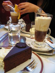 Cafe Culture in Vienna (Austria). 'This is what the Viennese mean by Gemütlichkeit (cosiness), you realise, as you sip your Melange (milky coffee), rustle your newspaper and watch life go decadently by. Café Sacher for the richest of chocolate cakes. Vienna Restaurant, Chocolates, Voyage Europe, Coffee Cafe, Coffee Shop, The Best, Food Porn, Sweets, Snacks
