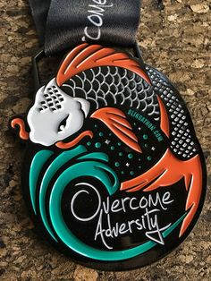 """""""Overcome Adversity"""" virtual run. Ancient tales have formed the mythical symbolism of Koi fish. Koi are often admired for their endurance and perseverance in the face of adversity, as seen on this medal with the Koi fish leaping over the waterfall. Many people have overcome large obstacles in their lives; let the Koi fish be your symbol of survival, bravery and determination. Run or walk this virtual 5K, 10K. Just cover the distance on your own time before the end date."""