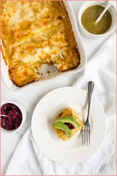 Want a great way to use up your inevitable Thanksgiving leftovers? Try these turkey enchiladas with butternut squash cheese sauce, topped with cranberries. Sweet Potato Biscuits, Mashed Sweet Potatoes, Roasted Butternut, Butternut Squash, Turkey Enchiladas, Mexican Food Recipes, Ethnic Recipes, Cabbage Recipes, Cheesy Sauce