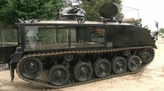 STRANGE MILITARY EQUIPMENT - CONVERTED TANK FOR MILITARY FUNERALS - GLASS SIDES FOR COFFIN DISPLAY