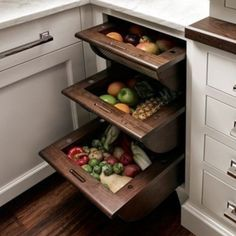 Building fruit and vegetable drawers into your kitchen results in a great way to store produce!