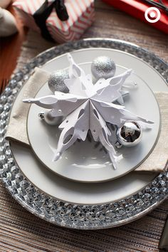 No two snowflakes are alike, and no two table settings have to be, either. Give everyone a special spot at the table with personalized place settings, like festive ornaments and bit of shimmer.