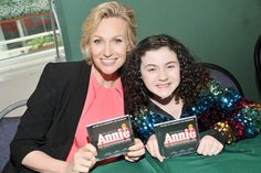 Jane Lynch and Lilla Crawford pose with  the new ANNIE CD before signing for fans.