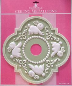 Ceiling Medallion in bunny design by Marie Ricci Collection. Shown in pale green distressed. www.mariericci.com