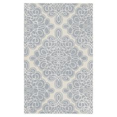 Anchor your living room seating group or define space with this artfully hand-tufted New Zealand wool rug, showcasing a scrolling medallion motif .