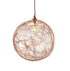 Copper home accessories are extremely versatile and complement a variety of interior styles. Create a statement in your home with this hand-crafted copper pendant light. Well-suited to any room in the home, once connected, this copper lamp shade creates a distinctive display of light across the space. The perfect finishing touch for Scandi and industrial style interiors, its delicate design features a collection of copper wires entwined in a spherical shape. Due to its hand-made nature, each…