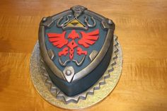 Funny pictures about Awesome Legend of Zelda Hylian Shield Cake. Oh, and cool pics about Awesome Legend of Zelda Hylian Shield Cake. Also, Awesome Legend of Zelda Hylian Shield Cake. The Legend Of Zelda, Zelda Birthday, Birthday Cake, Happy Birthday, Cupcakes, Cupcake Cakes, Zelda Cake, Best Cake Ever, Fancy Cakes